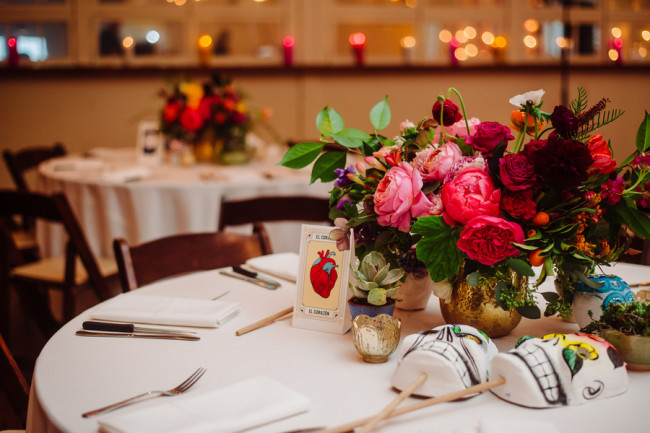 Day of the Day themed Wedding reception at Palm Door with pink yellow green flowers  with skull masks