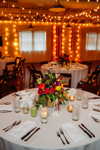 Day of the Day themed Wedding reception at Palm Door with pink yellow green flowers and white Christmas lights