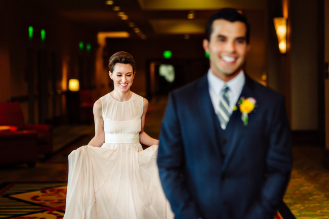 Bride walking up to groom in blush pink dress for a first look