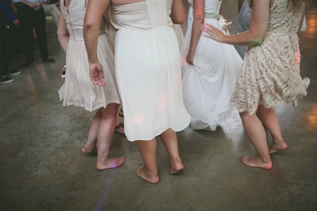 Bride and bridesmaids dancing in bare feet