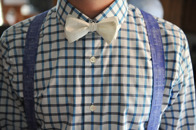 Groom wearing a white bow tie