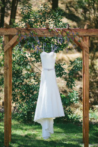 gown hanging from arbour