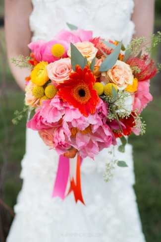billy balls with pink and orange flower bouquet