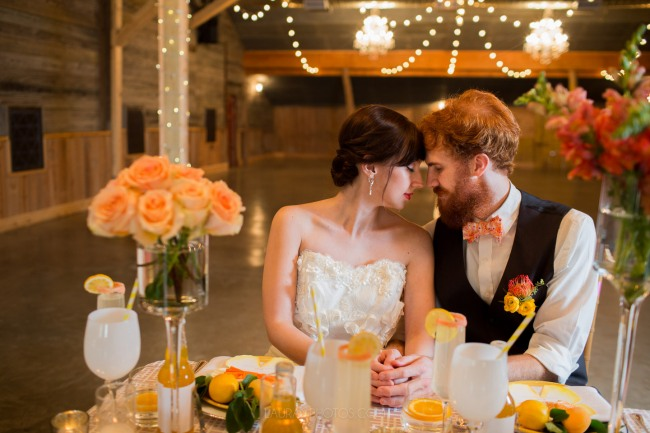 couple at styled table with lemon drinks