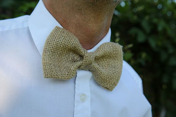 Groom wearing a burlap bow tie
