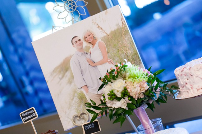 bride and groom engagement photos on canvas at dessert table
