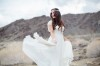 bride twirling wedding dress in califonia desert