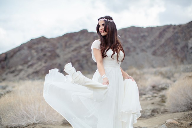 bride twirling wedding dress in califonia desert
