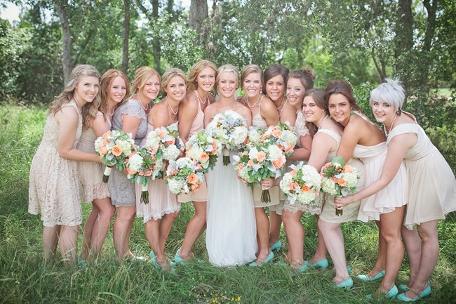 bride with bridal party in mismatched dresses