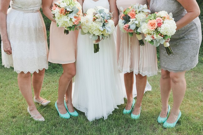 bride with bridesmaids in mismatched lace dresses holding bouquets with pink roses and white hygrageas