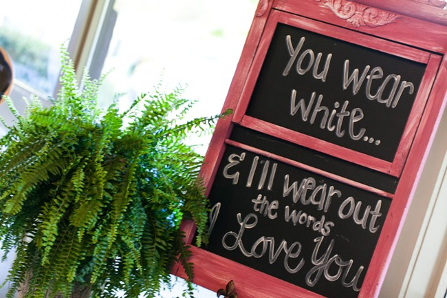 chalk board sign daying you wear white and ill wear out the words I love you