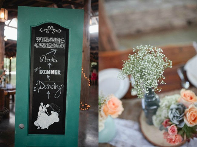 chalkboard wedding welcomes sign and a grey vase with babys breat