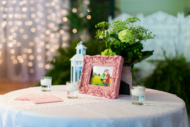 cocktail table with ornate frame and engagement photos