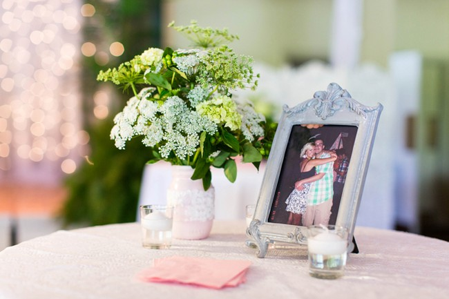grey  frame with engagement photo and white lantern on wedding reception cocktail table