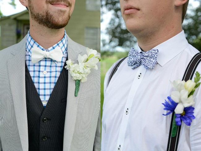 groom and groomsmen with white and blue bowtie and suspenders