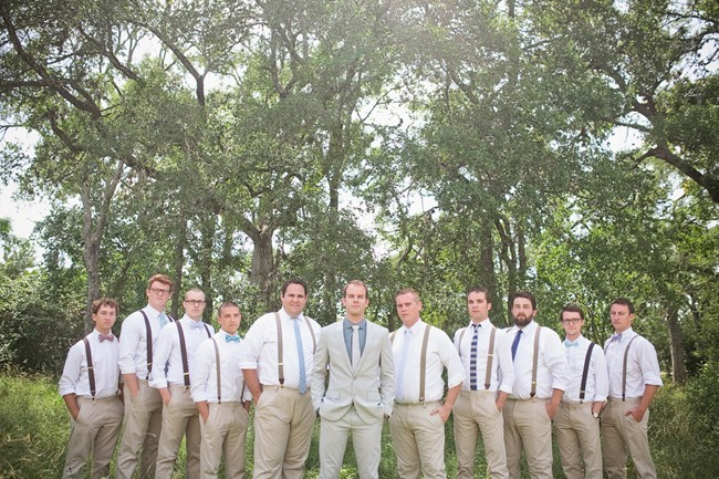 groom with groomsmen in mismatched ties and bow ties
