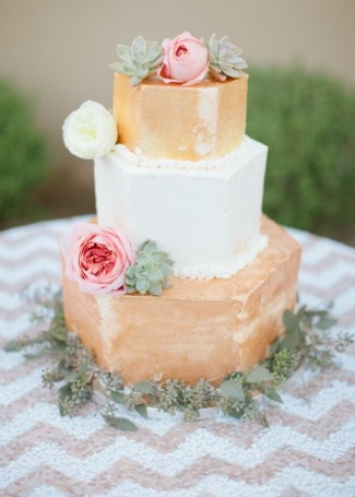 3 Tier white and gold cake with pink and white roses and succulence plants