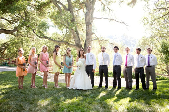 mismatched bridesmaids dresses in blue and pink yellow orange