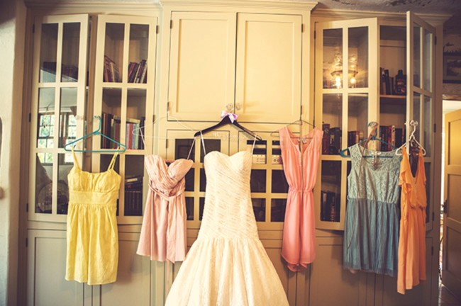mismatched bridesmaids dresses yellow pink orange and blue
