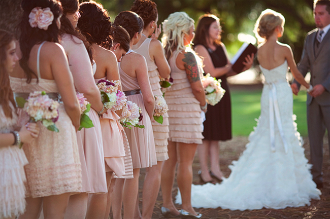 mismatched pink bridesmaids dresses during ceremony