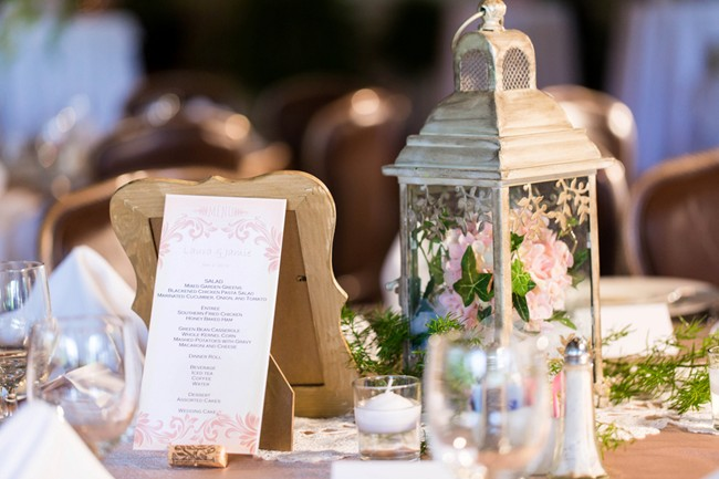 pink wedding menu and white lantern with pink hydrangea