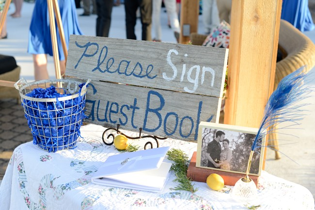 please sign guest book wooden sign with blue feather pen