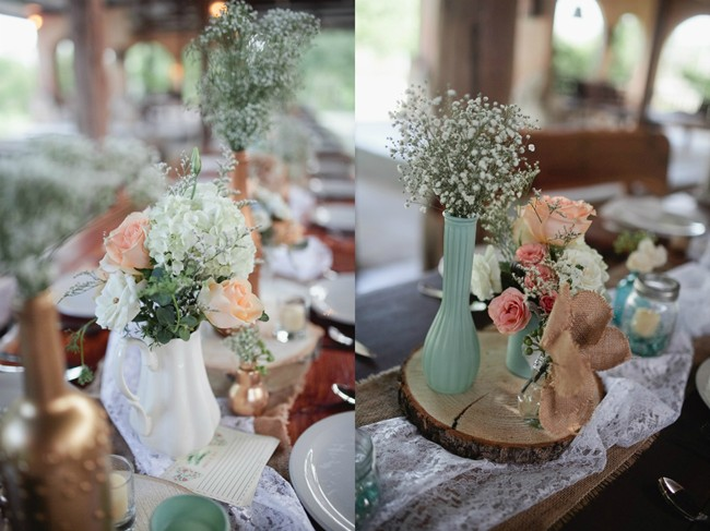 wedding reception table center peices with wood and white vase and white hydragea, pink roses and babys breath
