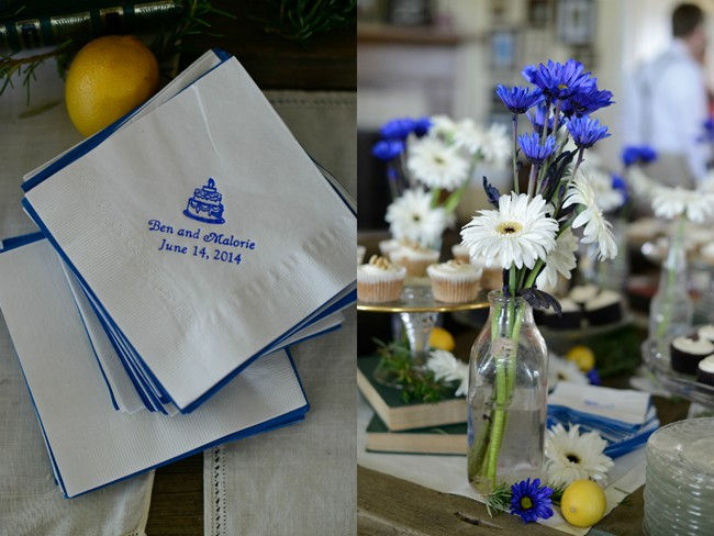 white and blue wedding reception napkins and flowers