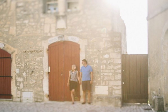 Holding hands in front of wood door in Provence
