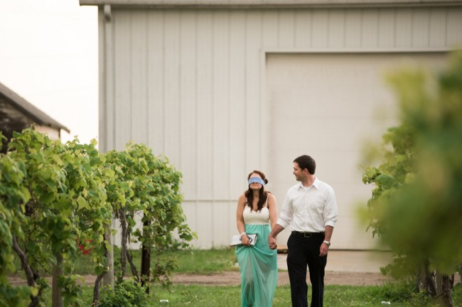1 DAVENPORT WINERY engagement shoot girl blind folded walking up vinyard before proposal