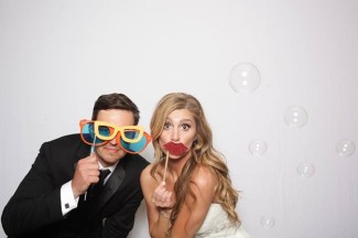 groom with giant glasses and bride with fake giant lips