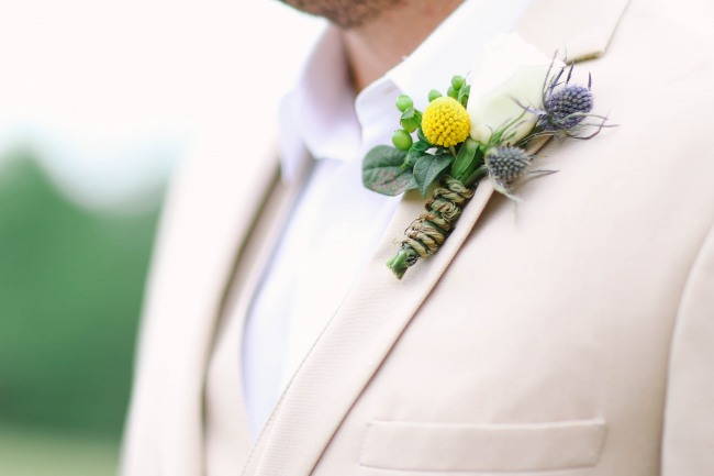 12 Groom with yellow and purple boutoniere at  Lindsey Plantation in Greer SC wedding