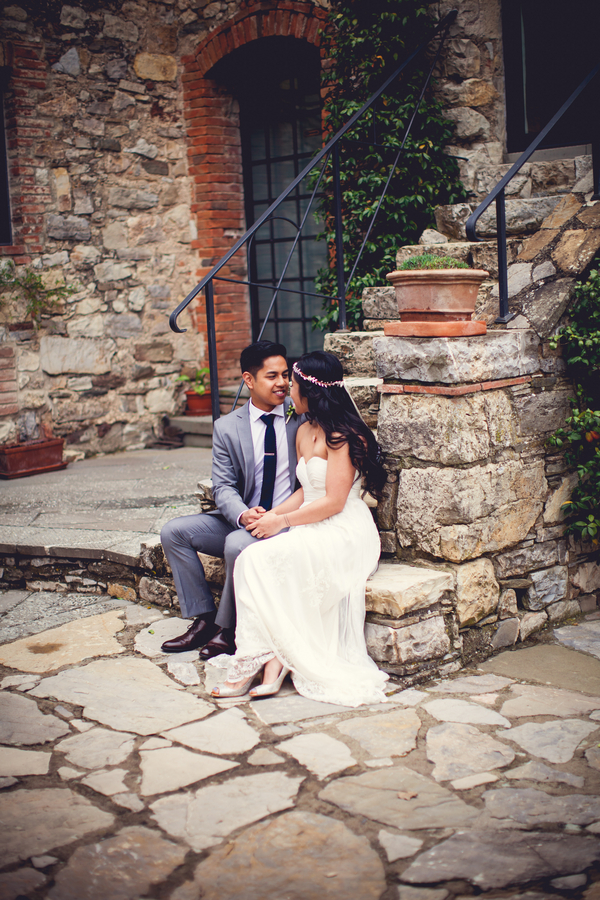 16 Bride and groom sitting on stairs at Livernano Radda in Chianti Tuscany, Italy before wedding