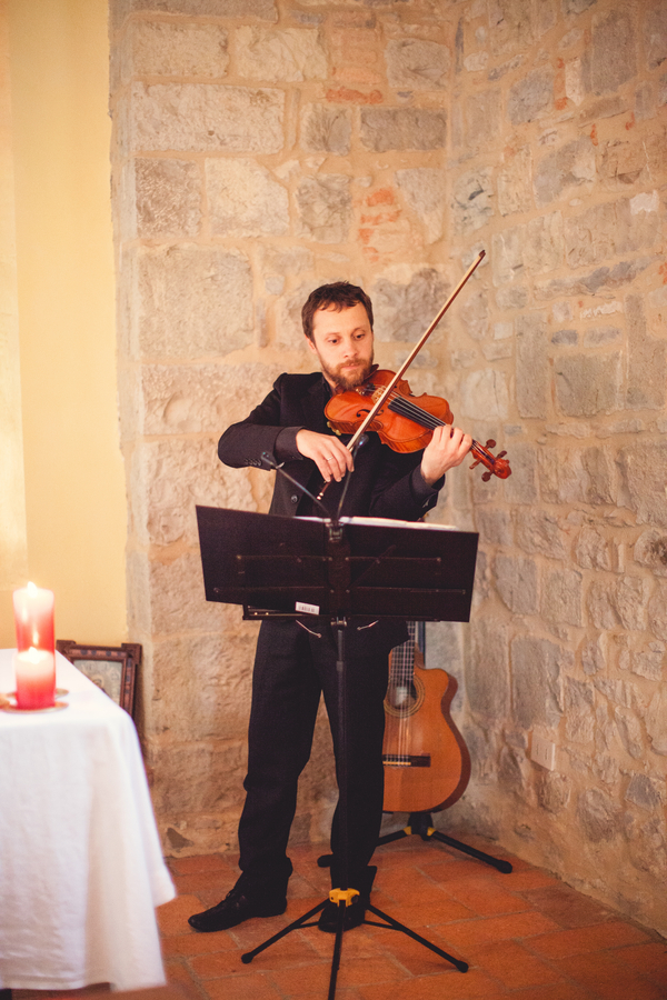 16 violinist playing violin during wedding ceremony at Livernano Radda in Chianti Tuscany, Italy