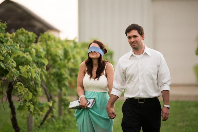 2  DAVENPORT WINERY engagement shoot girl blind folded walking up vinyard before proposal