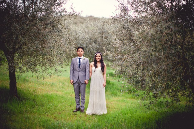 22 bride and groom standing in olive orchord at Livernano Radda in Chianti Tuscany, Italy