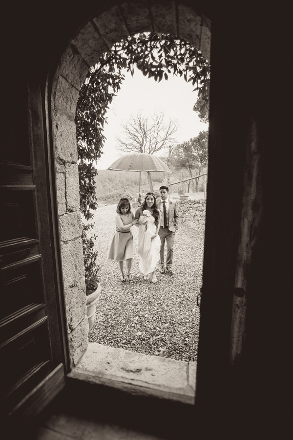 23 bride walking to wedding ceremony at at Livernano Radda in Chianti Tuscany, Italy