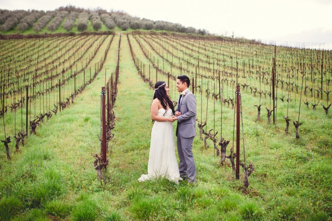 24 bride and groom standing in vinyard at Livernano Radda in Chianti Tuscany, Italy