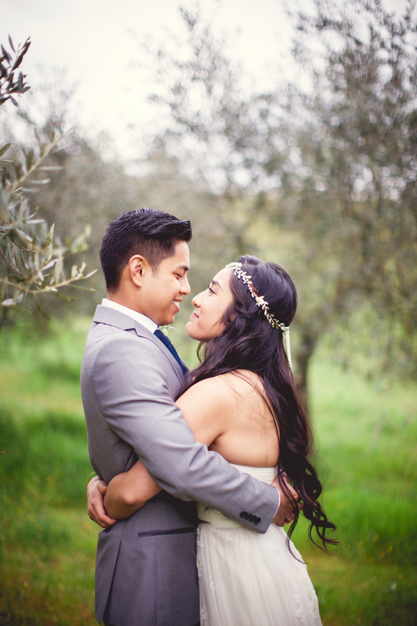 25 bride and groom standing in olive orchord at Livernano Radda in Chianti Tuscany, Italy