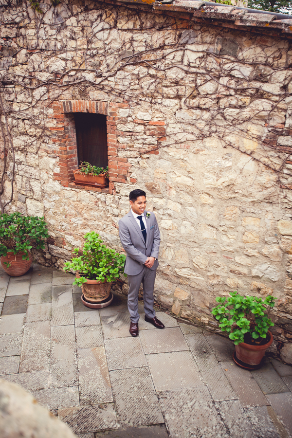 25 groom waiting for bride at Livernano Radda in Chianti Tuscany, Italy