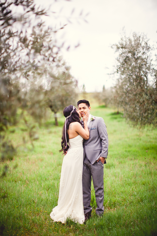 26 bride whispering to groom in an olive orchard at Livernano Radda in Chianti Tuscany, Italy