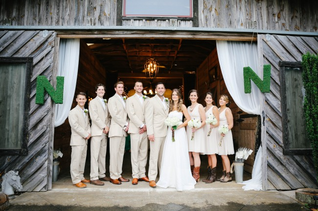 29 Bridal party in cream and white standing in door way at  Lindsey Plantation in Greer SC wedding