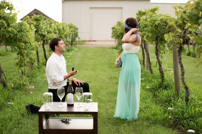 3 DAVENPORT WINERY engagement shoot girl taking blind folded off in vinyard as guy down on one knee proposing