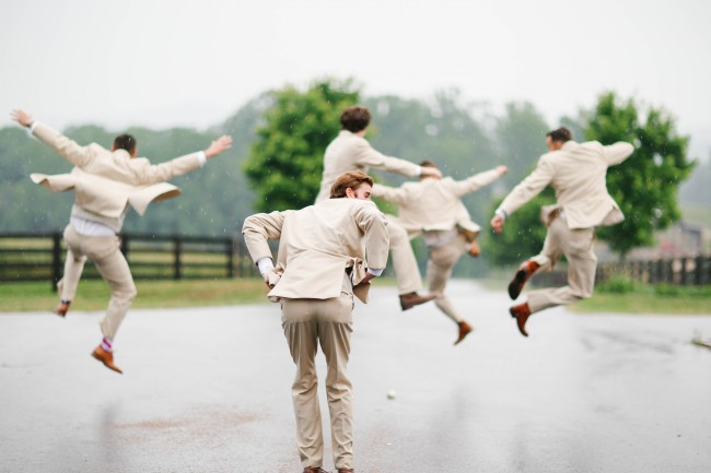 31 Groomsmen jumping in air and kicking heels in cream suits at  Lindsey Plantation in Greer SC wedding