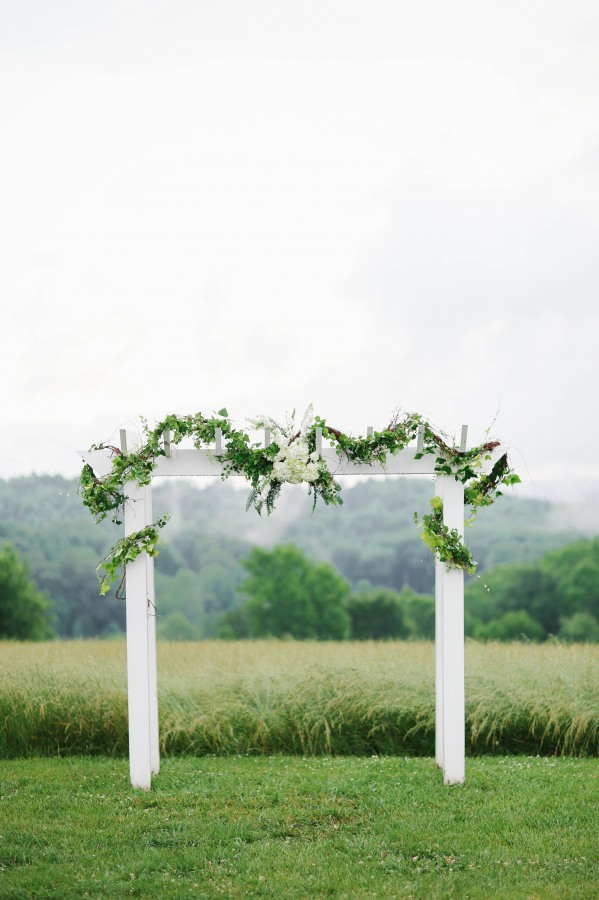 37 white wedding altar with greenery at  Lindsey Plantation in Greer SC outdoor wedding
