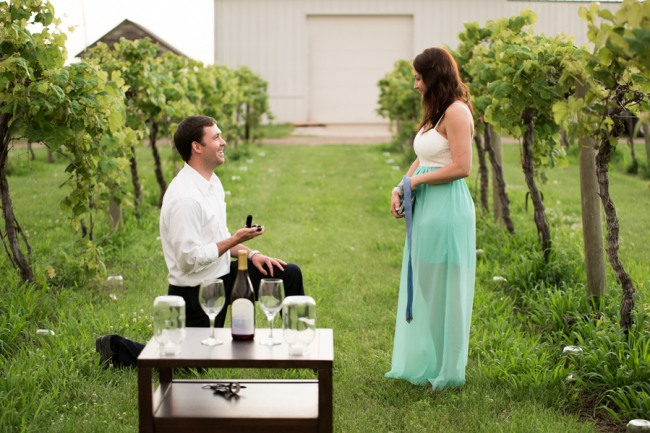 DAVENPORT WINERY engagement shoot girl taking blind folded off in vinyard as guy down on one knee proposing