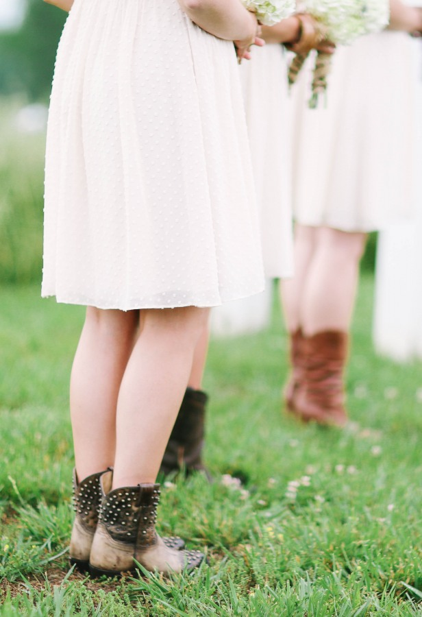 43 Bridemaids wearing cow boy boots at wedding ceremony at  Lindsey Plantation in Greer SC