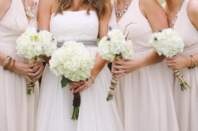 46 Bride and bridesmaids wearing j crew holding white wedding bouquet of hydrageas at  Lindsey Plantation in Greer SC wedding