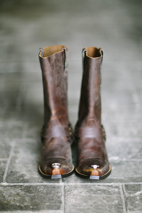 5 Cow boy boots and wedding rings places on the toes of the boot at  Lindsey Plantation in Greer SC wedding