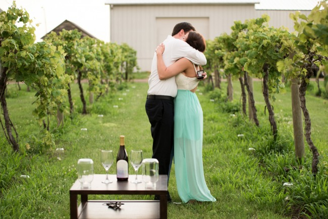 DAVENPORT WINERY engagement shoot couple embracing after she says yes